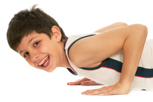 A sporty boy is pushing up; isolated on the white background